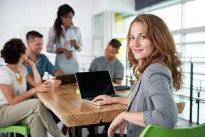Image of a succesful casual business woman using laptop during meeting-1
